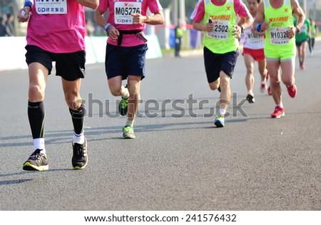 XIAMEN,CHINA - JANUARY 3: Unidentified marathon runners on the street at Xiamen  International Marathon JANUARY 3, 2015 in Xiamen, China  - stock photo