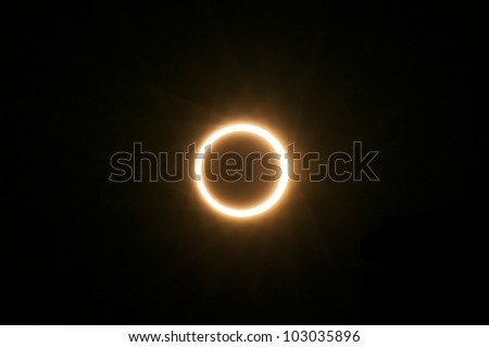 XIAMEN, CHINA - MAY 20:  The moon passes in front of the sun on May 20, 2012 which creates a total solar eclipse seen from Xiamen, China. - stock photo