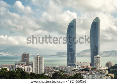 Xiamen new landmark twin towers world trade strait building. because appearance resembles bayonet, was friendly laughed as two swords. the world trade strait building is about 300 meters high,