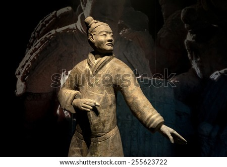 XIAN - APRIL 9: exhibition of the famous Chinese Terracotta Warriors on April 9, 2014 in XIan, China. The terracotta warriors are made in 210-??209 BCE to protect the emperor in his afterlife. - stock photo