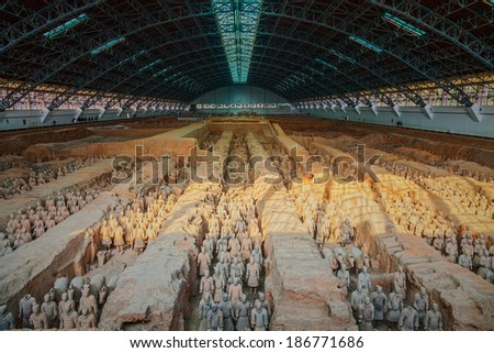 "XIAN,CHINA -MAR 24 :The Terracotta Army or the ""Terra Cotta Warriors and Horses"" buried in the pits next to the Qin Shi Huang's tomb in 210-209 BC. March 24, 2014 in Xian of Shaanxi Province, China.  - stock photo"