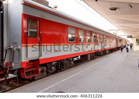 XIAN, CHINA - MAR 29, 2016: Train on a platform at the Central Railway station of Xian, China. THe most populated railway station in Xian, China. - stock photo