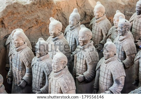 XIAN,CHINA OCT 23, 2013:The Terracotta Army or the Terra Cotta Warriors and Horses buried in the pits next to the Qin Shi Huang's tomb in 210-209 BC in Xian of Shaanxi Province, China. - stock photo