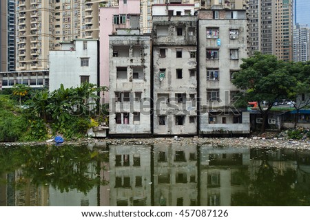 Xian village, Guangzhou, CHINA - JULY 16, 2016: Xian Cun, a village absorbed by the new town. The government announced the demolition of the old buildings. But inhabitants fight for their homes.