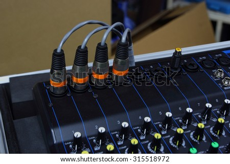 XLR signal on electronic mixer close. - stock photo