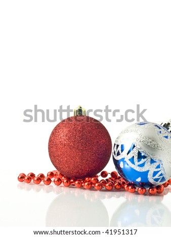 Xmas and New Year greetings - colorful decoration balls over white