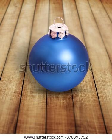 Xmas ball on wood - stock photo