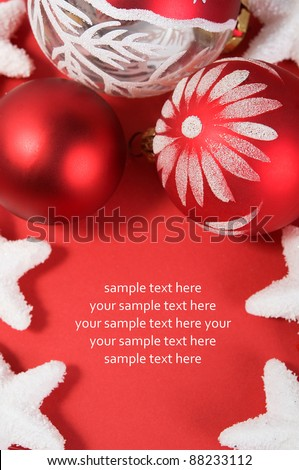 Xmas decoration on the red with copy space. Vertical composition.