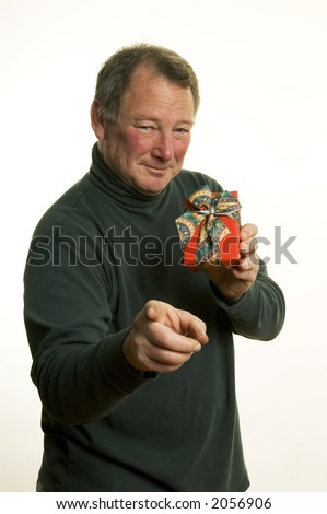 xmas man with holiday gift pointing - stock photo