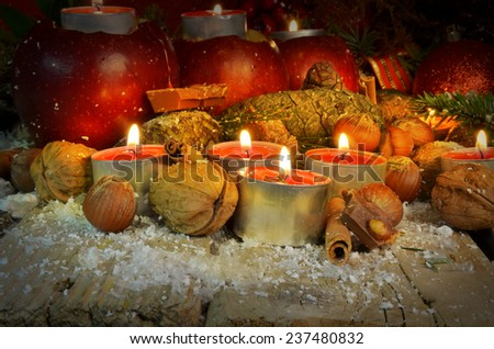 xmas night candles- nuts firs pine cones and apples - merry Christmas - stock photo