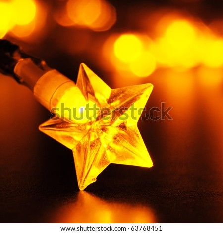 xmas or christmas holiday star lights with copyspace - stock photo