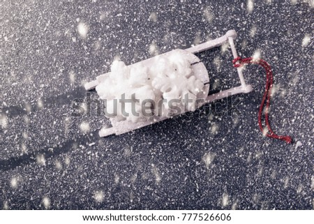 Xmas sledge with decorative snowflake on snowy background