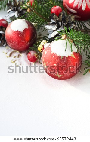Xmas tree and baubles on the snow - stock photo