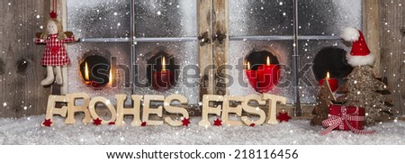 Xmas wooden window decoration with red candles for a german greeting card with text: Merry Christmas. - stock photo