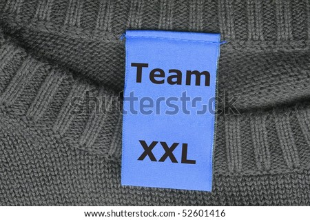 xxl team or teamwork concept with fashion label