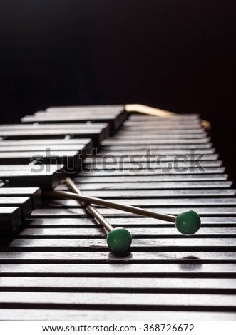 Xylophone with two mallets. Dark background. Close-up - stock photo