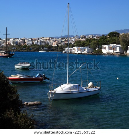 Yacht and Agios Nikolaos City, Crete, Greece