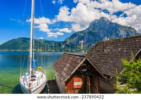 Yacht and boathouse on Traunsee lake in summer, Austria - stock photo