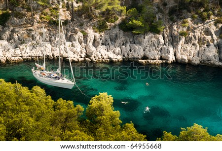 Yacht and tree Swimmers in the Bay - stock photo