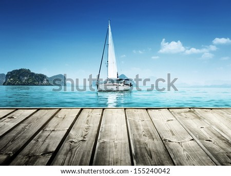 yacht and wooden platform - stock photo