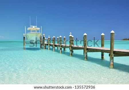Yacht at the wooden jetty. Exuma, Bahamas - stock photo