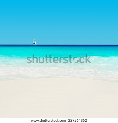 Yacht at tropical sandy beach. Anse Georgette, Praslin island, Seychelles - vacation background - stock photo