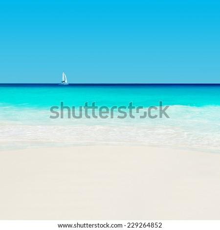 Yacht at tropical sandy beach. Anse Georgette, Praslin island, Seychelles - vacation background - stock photo