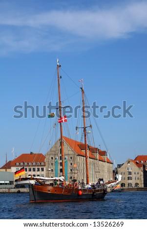 Yacht entering Copenhagen haven - stock photo
