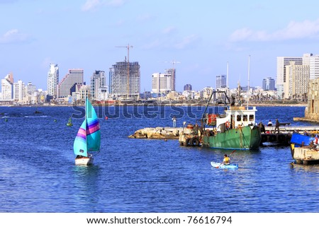 Yacht, floating into port of the old city of Yaffo (Israel) - stock photo