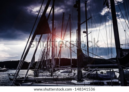 Yacht harbor at night, beautiful luxury water transport in moonlight, yachting sport, marina in sunset light, summer vacation and traveling concept - stock photo