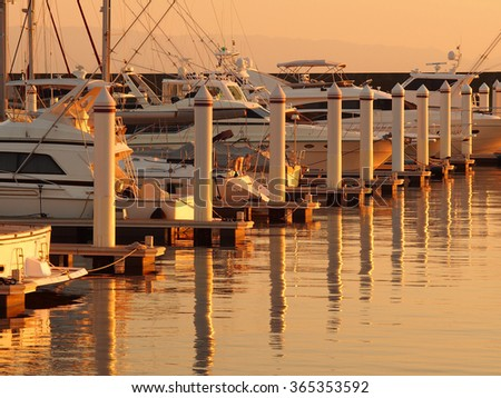 Yacht harbor in evening time, under evening sunlight. - stock photo