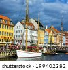 Yacht in Copenhagen sea front in summer. Nyhavn is old waterfront and canal district - stock photo
