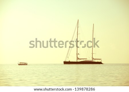 Yacht in the sea near island in Indian ocean