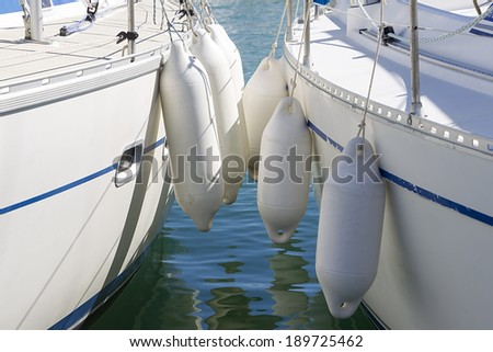Yacht moored in harbor - stock photo