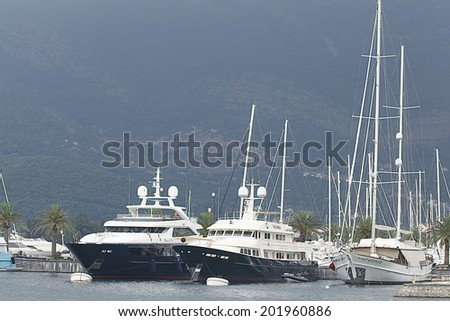 yacht on the sea in the port - stock photo