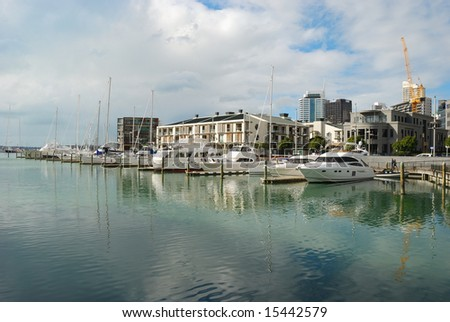 yacht parks outside luxury apartment - stock photo