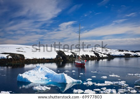 yacht sailing among the glaciers in Antarctica - stock photo