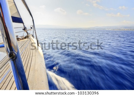 Yacht sailing fast with the wind - stock photo
