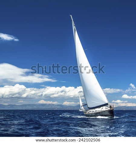 Yacht sails with beautiful cloudless sky. Sailing. Luxury yacht. - stock photo