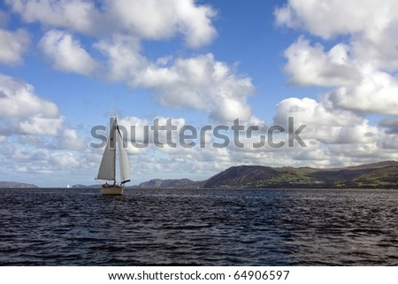 Yacht under sail in the Menai Straits in Summer - stock photo