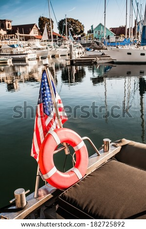 Yacht with American flag At The Pier On A Sunny Day on the dock in Long Beach California - stock photo