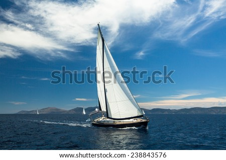 Yachting. Boat in sailing regatta. Luxury yachts. - stock photo