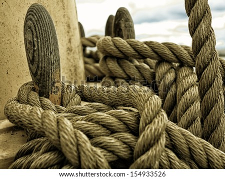 Yachting. Sailboat in the sea view of different parts of yacht, Nautical mooring ship rope. Detail of a sailing boat - stock photo