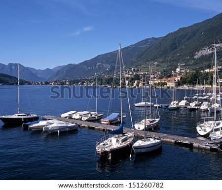 Yachts along jetties and lake shoreline, Lake Como, Tremezzo, Lombardy, Italy, Europe.