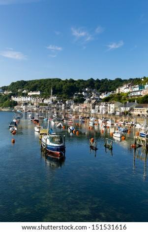 Yachts and boats looe river cornwall england uk with blue sea and sky