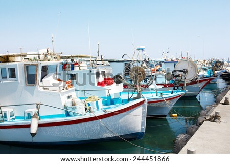 Yachts and fishing boats in Larnaca port, Cyprus. - stock photo