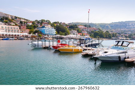 Yachts and pleasure motor boats are moored in marina of Balchik, Bulgaria - stock photo