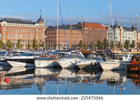 Yachts and pleasure motor boats moored in central marina of Helsinki, Finland - stock photo