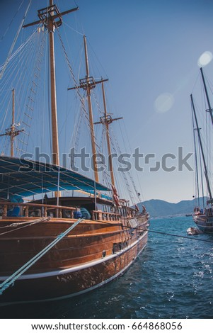Yachts and ships in the bay of the sea