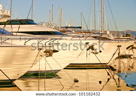 Yachts in a port during the sunset - stock photo